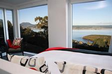 guest luxury accommodation- bed with a view