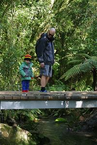 Father and child admire the stream