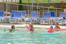Family Enjoying The Thermally Heated Pool