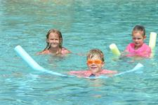 Children Enjoying The Thermally Heated Swimming Pool