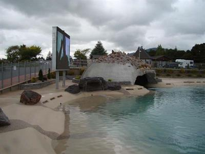 Grotto Cave With Waterfall & Giant TV Screen