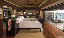 6b - Conrad Bora Bora Nui - Deluxe Overwater Villa bedroom Conrad Bora Bora Nui
