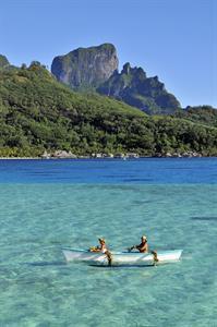 c - breakfast-delivery-by-outrigger-canoe-at-the-i Intercontinental Le Moana Bora Bora