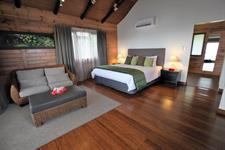 Aga Reef Resort - Waterfront Villa lounge and bed Aga Reef Resort