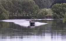 Speeding across the glassy lake