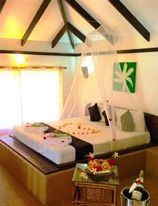 Amoa Resort - Poolside Villa bed Amoa Resort