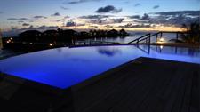 Aga Reef Resort - pool at night Aga Reef Resort