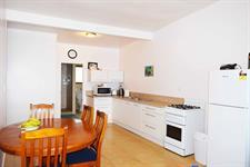 Henry Villa - Dining table and kitchen area Henry Villa