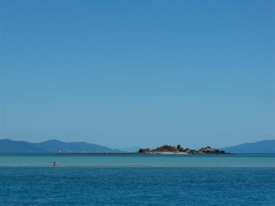 Langford Reef with Airlie Beach in the background