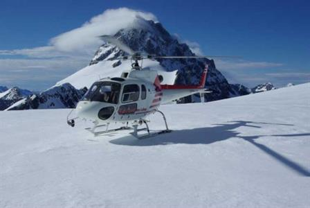 Helicopter on Snow Covered Mountain top
