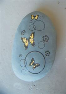 Butterflies engraved on riverstone