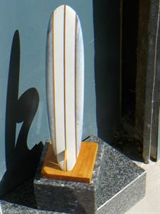 Carved marble surfboard