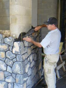 Master Mason Paul Gautron building with Matatoki s