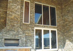New Schist Home outdoor fireplace