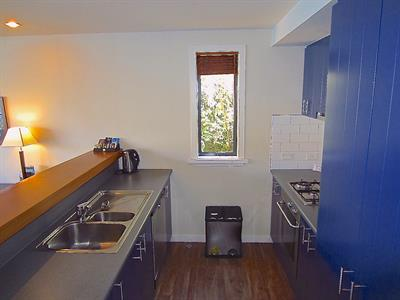 2 & 3 Bedroom kitchen blue Villa del Lago