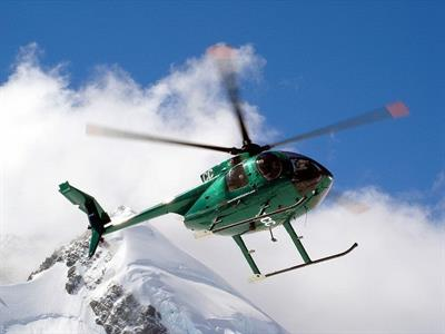 Chopper above the mountains