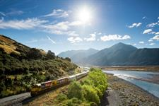 TranzAlpine, train Alongside Waimakariri River. Christchurch to Greymouth Meetings on the Move West Coast