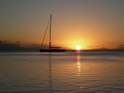 a - Royal Huahine -  a sailboat at sunset
