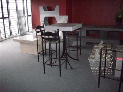 Setting: Bar table with bar chairs