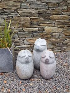 carved three little pigs river stone