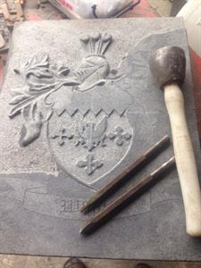 carving family coat of arms
