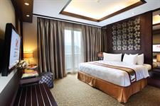 Presidential Suite Bedroom Swiss-Belhotel Danum Palangkaraya