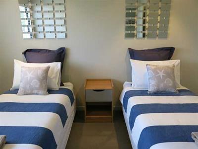 Twin beds in your 2 bedroom apartment Ocean Breeze