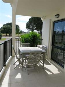 Sunny private patio Ocean Breeze