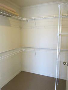 Huge walk in wardrobe in three bedroom apartment Ocean Breeze