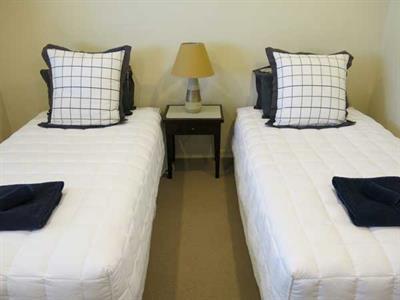 Twin bed sleeping in your three bedroom apartment Ocean Breeze
