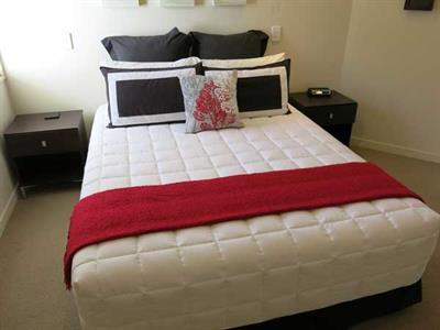 Rest well in your queen bed at Ocean Breeze Resort Ocean Breeze