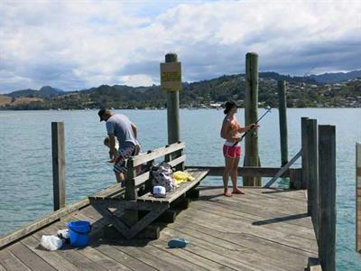 Spend a lazy afternoon fishing off the wharf Ocean Breeze