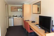 Convenient Desk & Kitchenette Space In Your Room