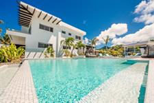 Standing by the pool Crystal Blue Lagoon Villas