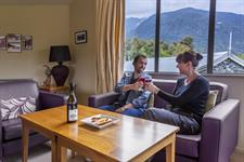 DH Fox Glacier - Enjoying Drinks in Guest Lounge RM8047