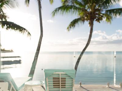breakfast on a Beachfront villa balcony at sunrise Crystal Blue Lagoon Villas