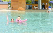 Kids Enjoying The New Swimming Pool