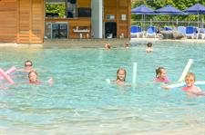 Children Enjoying The New Swimming Pool
