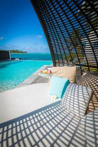 Lying in a daybed Crystal Blue Lagoon Villas