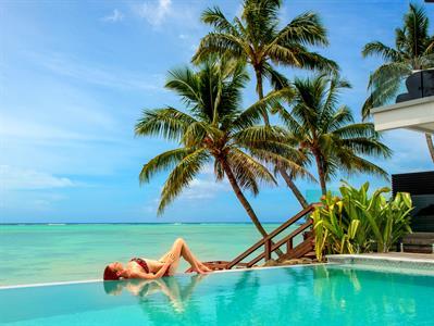 lying on the pool Crystal Blue Lagoon Villas