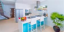 Beachfront villa kitchen Crystal Blue Lagoon Villas